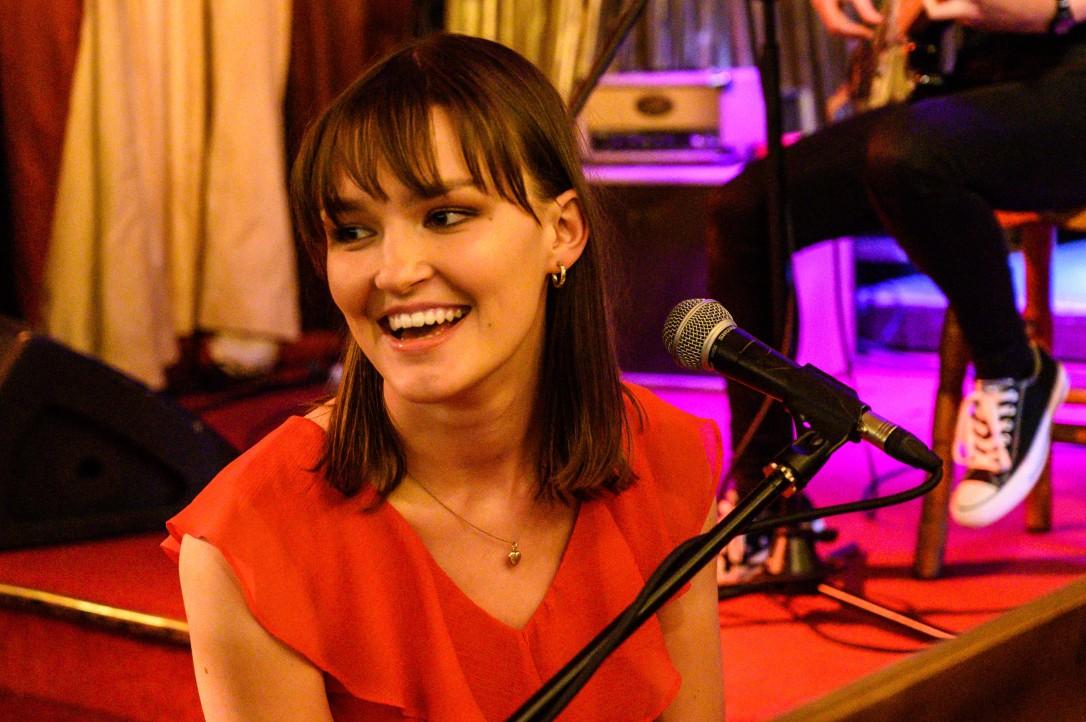 Josie piano smiling